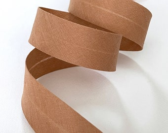 Bias plain camel color folded 2cm in 2 folds, sold by the cut by the meter