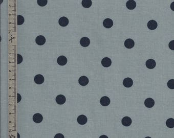 Blue-grey waxed canvas with midnight blue grey polka dots sold to the 10cm multiple cut