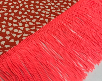 Galon has neon pink fringes in 10cm wide, sold by the meter