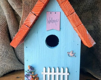 Light purple or light blue birdhouse, outdoor, hanging, easy cleaning and Michigan handcrafted.