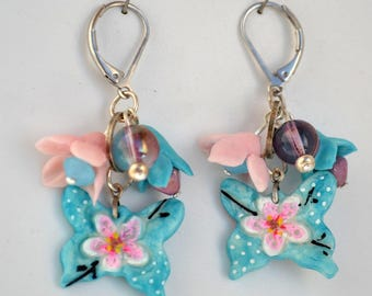 Beads and hand shaped porcelain earring