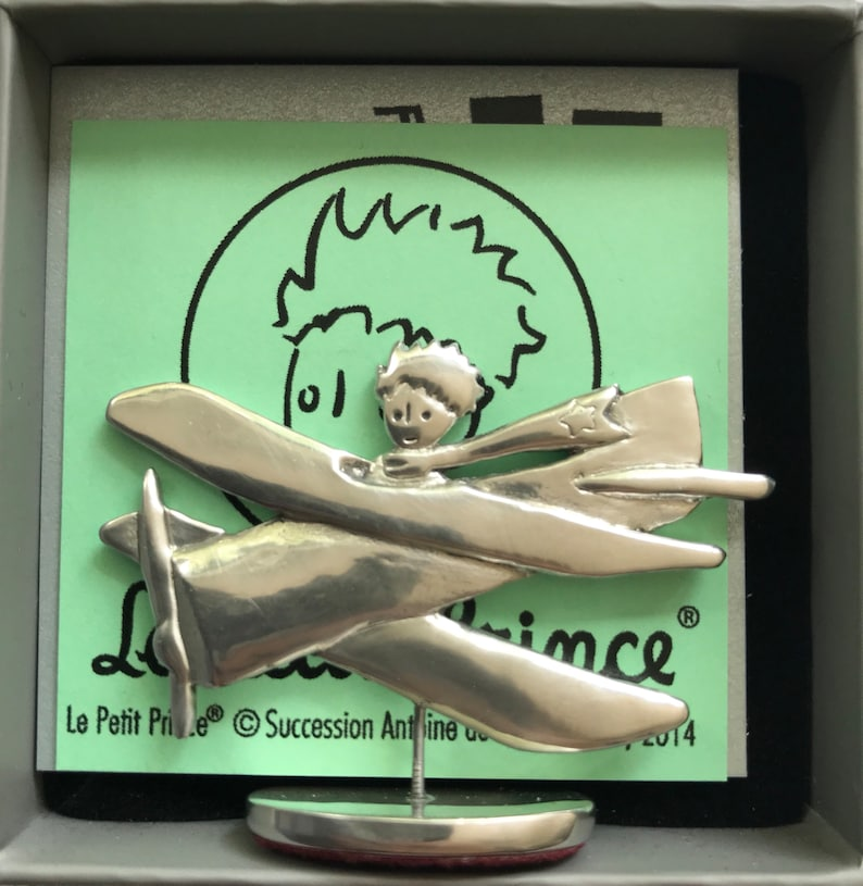 Tiny solid pewter airplane