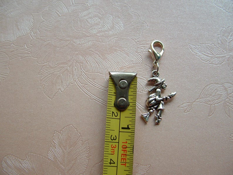 tibetan silver flying witch clip on charm