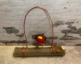 Robin clay figure on willow branch with copper wire hanger