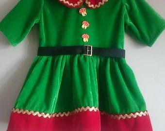 Girl dress elf for christmas.