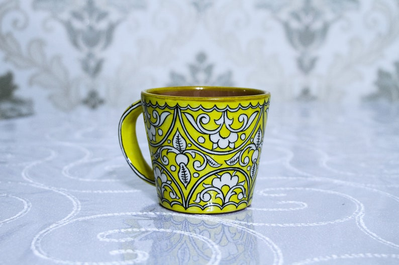 Yellow cup with oriental ornaments. Best gift image 0