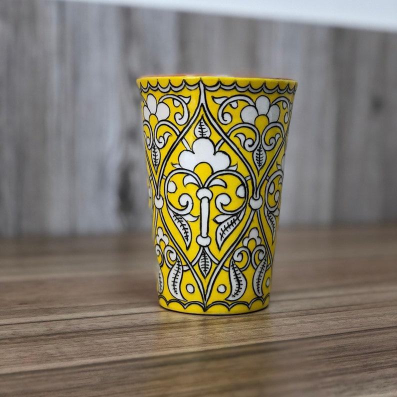Yellow latte coffee or ice tea ceramic cup with uzbek image 0
