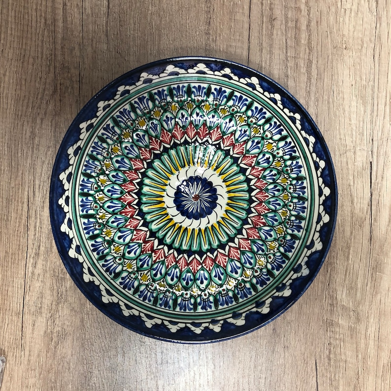 Blue ceramic dishes for one person with an oriental ornament image 0