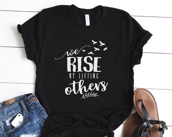 d947542f552 we rise by lifting others Shirt