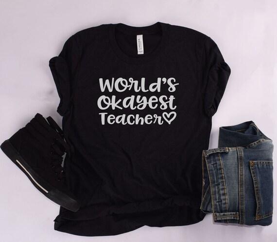 b26fc3ce126 World s Okayest Teacher Teacher Shirt Teacher Shirts