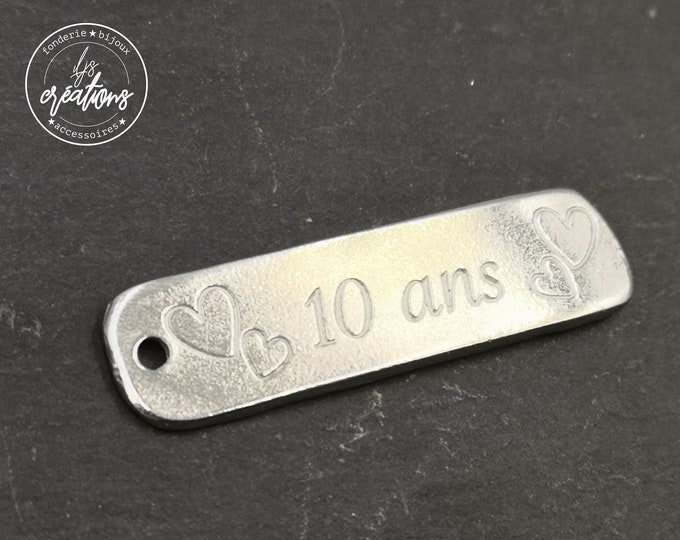 10x40mm tin medal - 10 years