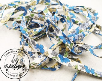 1m of folded frilly bias 8mm - flowery - blue and yellow