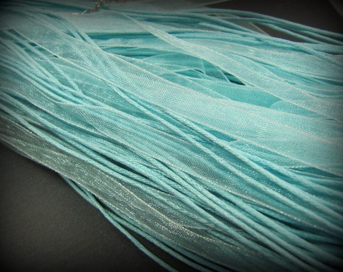 End of stock - 1 light blue organza neck circumference