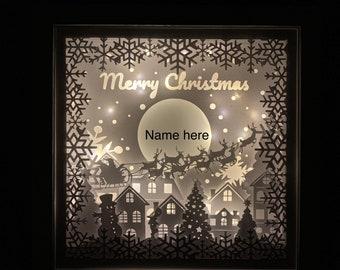 Santa's cabin Christmas 3D Paper cut, Santa sleigh Christmas winter with light, new year.