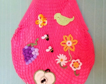 Mesh bag with customized crocheted fruits with bamboo handles.