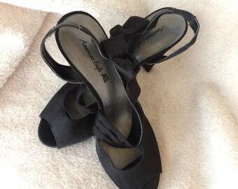 4addee6b41 Ladies shoes black Size 12 satin platform 5 inch heels runway diagonal  strap sandals American Eagle revolved