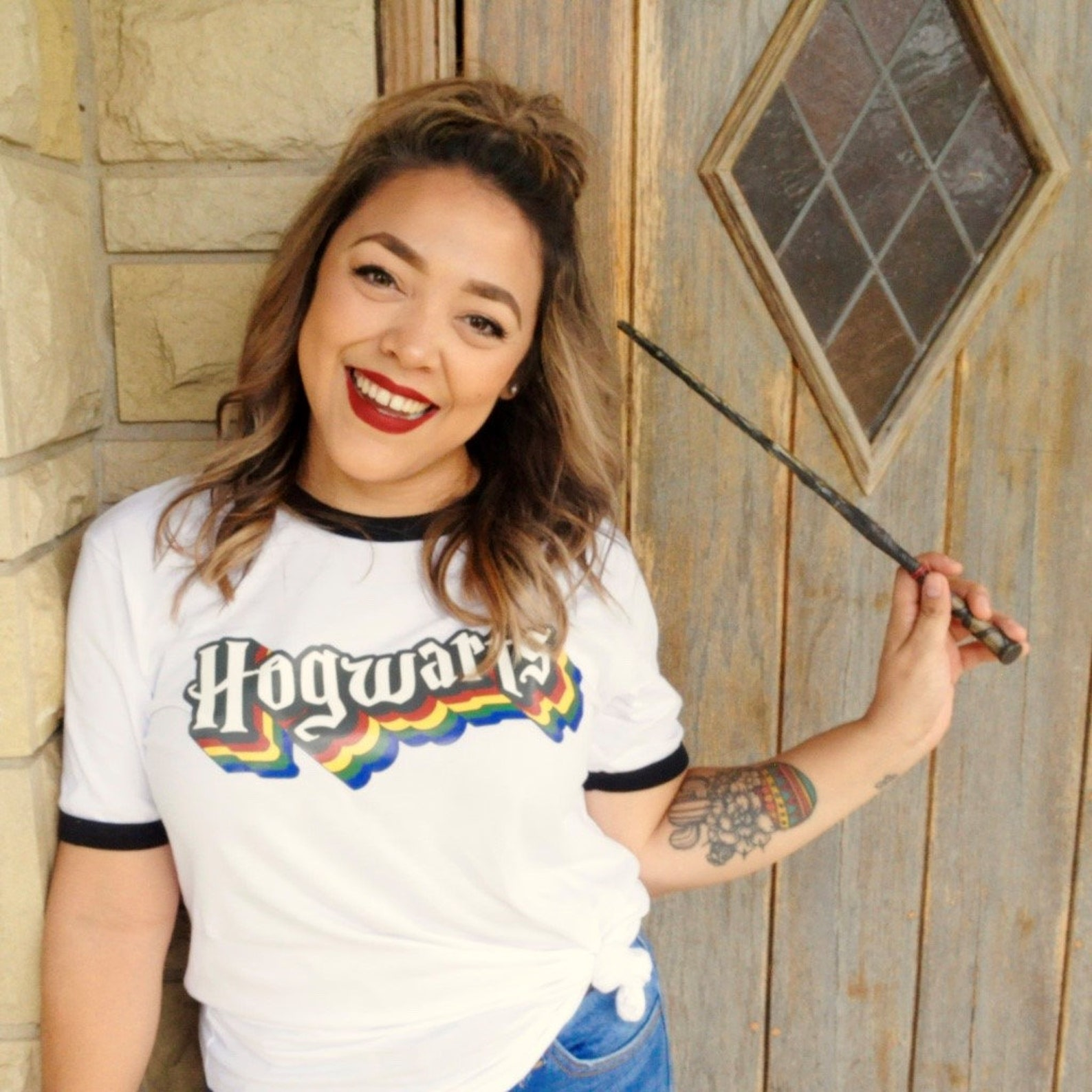 retro harry potter hogwarts tee on girl with wand.