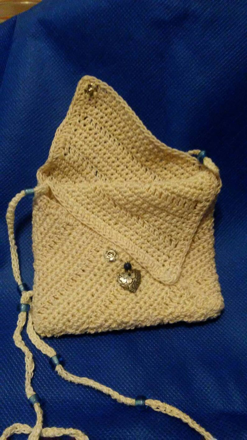 Entirely hand crocheted OOAK pocket on a strap type purse