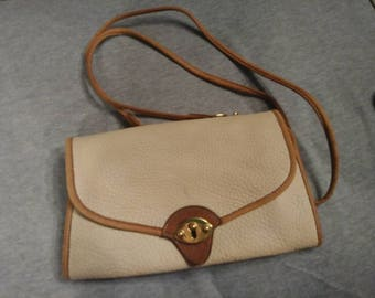 Dooney and Bourke purse. All Weather Leather- cross body bag- USA.