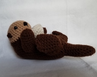Crochet sea otter with clamshell