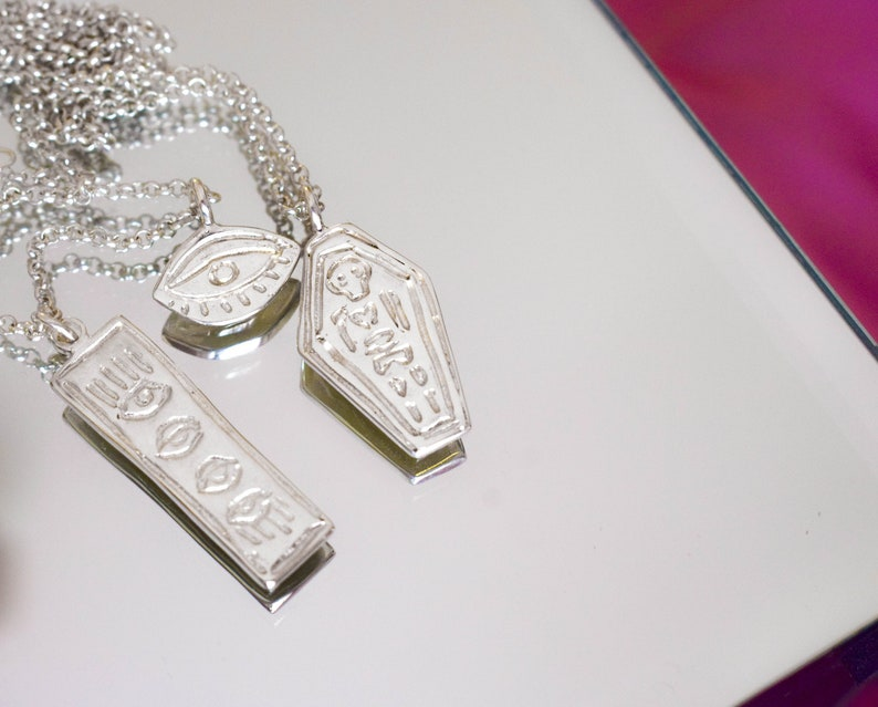 Skeleton in a coffin necklace