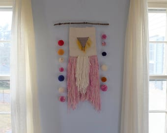 Woven Wall Hanging With Pom Pom Sashes