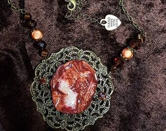 Vintage cameo Locket necklace rust cold porcelain