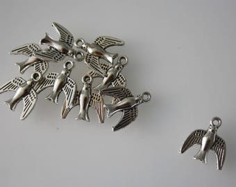 Set of 10 1.5 x 1.6 cm silver coloured bird charms. For jewelry and key ring.