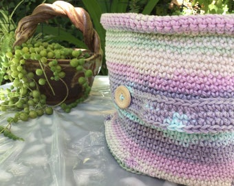 Hand crocheted basket in pastel cotton.