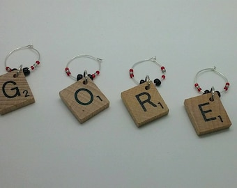 Wine glass charms. Horror fans. Gore whine charms. Scrabble tile wine charms. Word play. Scrabble.