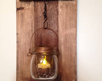 Wood wall hanging scone with glass candle holder.