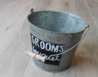 Metal pail with chalk sign