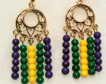 Long dangle Mardi gras glass bead earrings in purple green and gold