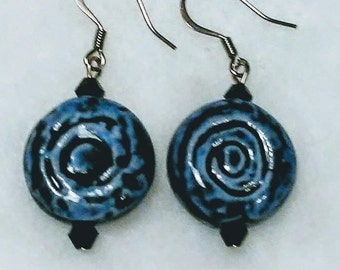 Dark blue swirl ceramic bead earrings with black accents