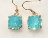 Light blue opalescent square faceted glass beads set in a gold metal prong setting earrings bridal showers baby maid of honor weddings trend