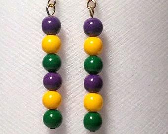 Mardi gras long medium sized glass bead earrings in purple green and gold