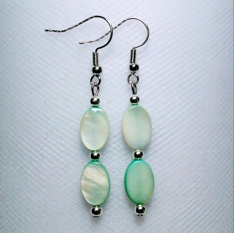 Mother of pearl dyed oval shell bead earrings with silver plated accents beautiful long light green teal aqua mint seafoam lightweight trend