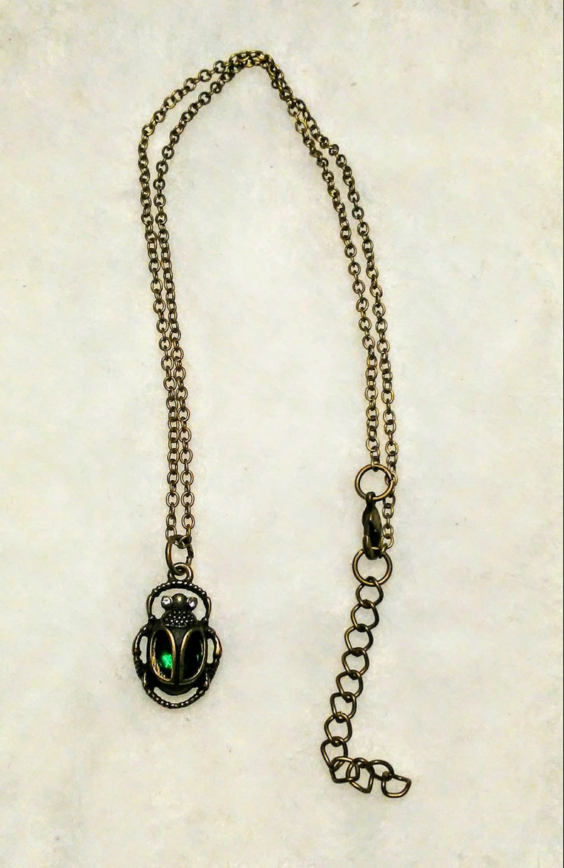 Egyptian scarab beetle in antique gold with a dark emerald green glass body necklace fantasy myths medieval beautiful Egypt treasures moms