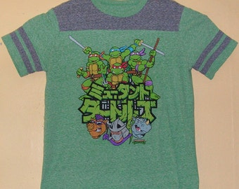 5e5374f7d 90s Teenage Mutant Ninja Turtles T-Shirt Adults size MEDIUM official  product TMNT comic con collection Vintage