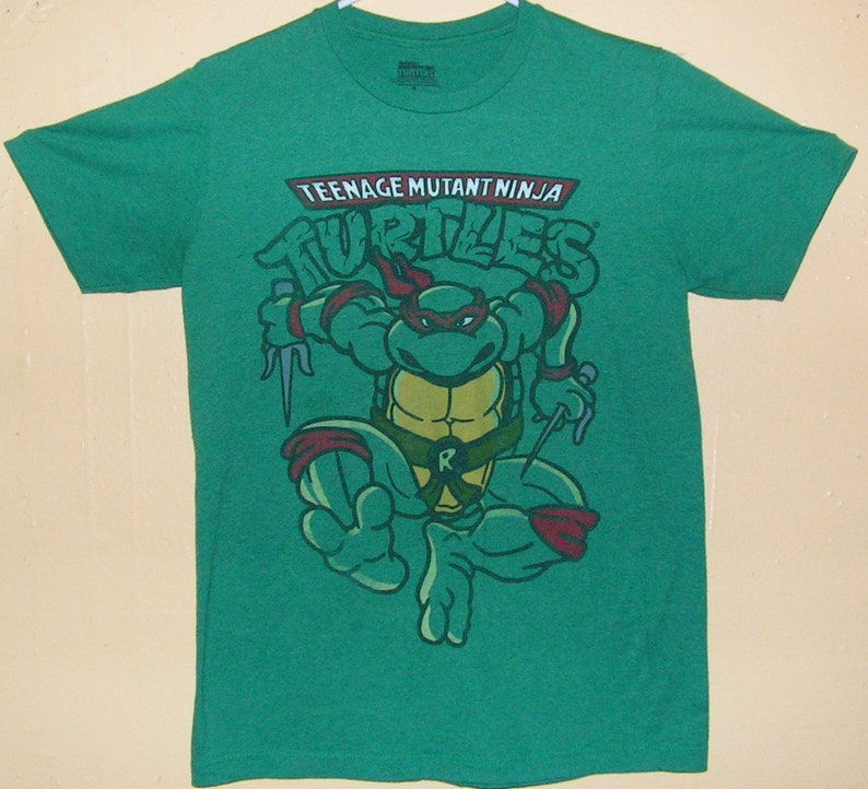 ec09671f93f81 90s Teenage Mutant Ninja Turtles T-Shirt Adults size SMALL official product  100% cotton TMNT comic con collection Vintage