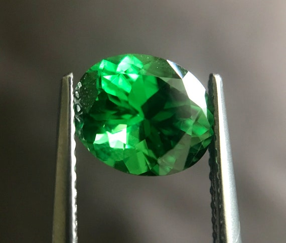 Natural round shaped tsavorite gems x 2...Excellent accent stones