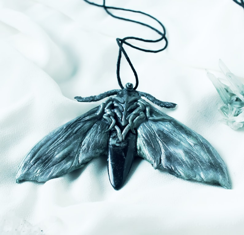 Two sided moth pendant with fossil talisman moth jewelry
