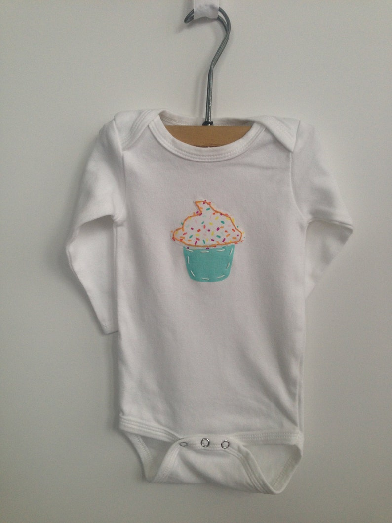 multiple sizes available Sprinkled celebration cupcake appliqued body suit
