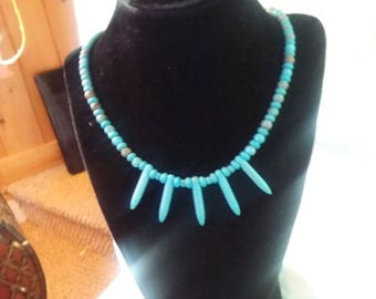 Turquoise tribal look necklace.