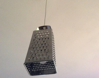 Hanging cheese grater