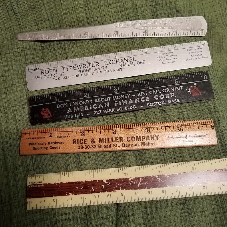 The aluminum Cooking Utensil co 6 inch ruler and 4 other rulers