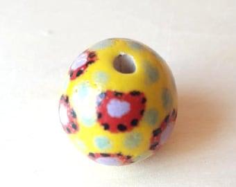 Yellow ceramic bead