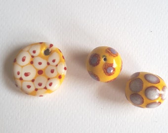 Pendant and 2 yellow ceramic beads