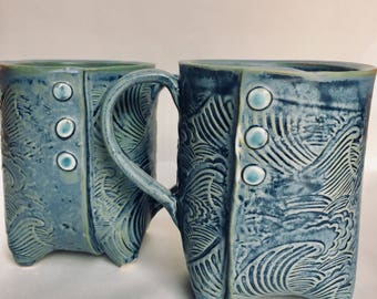 Waves footed mug