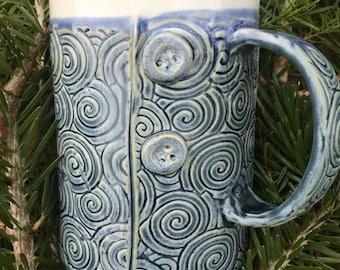 Blue swirl button mug